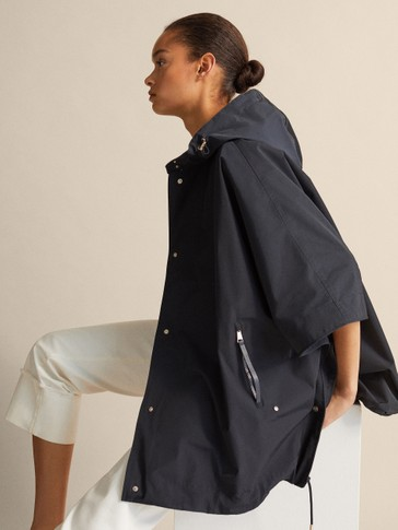 TECHNICAL NAVY CAPE WITH LEATHER DETAIL