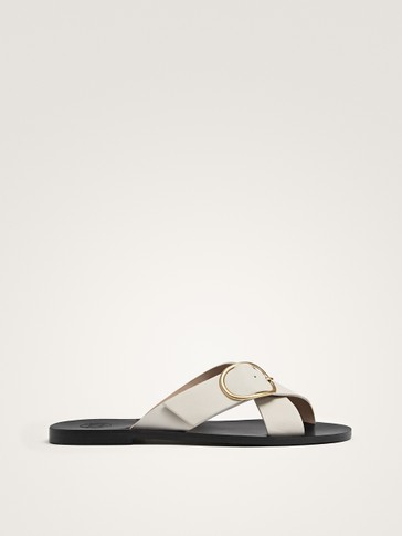 WHITE LEATHER CRISS-CROSS STRAP SANDALS WITH BUCKLE