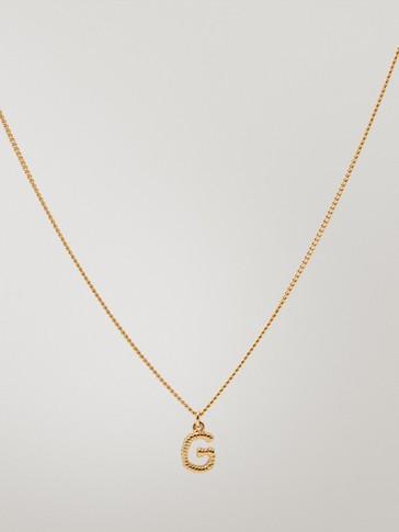 Collar letra G baño oro