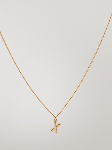قلادة مطلية بالذهب حرف X