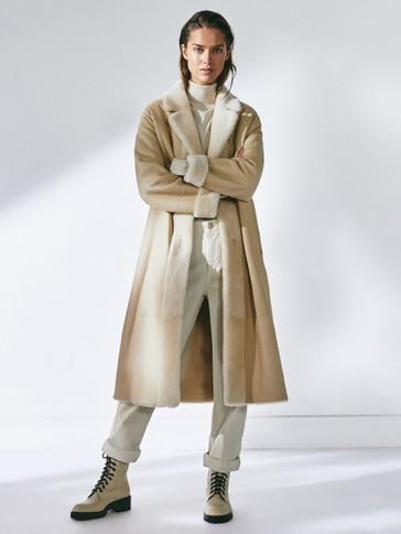 Manteau moutonné avec ceinture