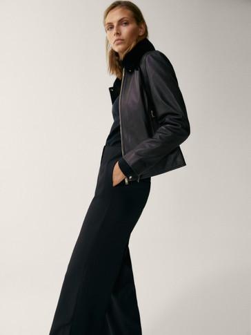 Jaqueta coll moltó extraïble negra