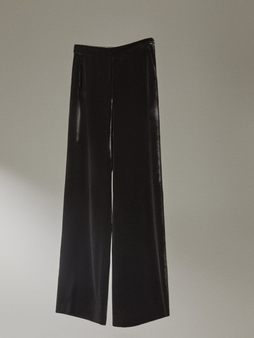 Black velvet trousers
