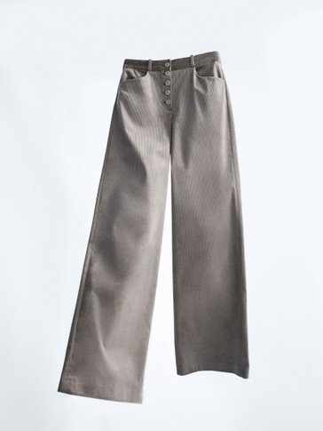 Buttoned corduroy trousers