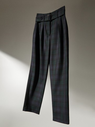 Check trousers with buckle belt