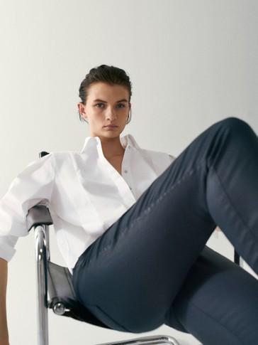 Mid-waist rubberised skinny fit trousers