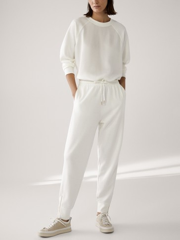 Jogging trousers with zipped hems