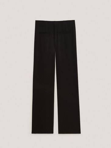 Black crepe split hem trousers