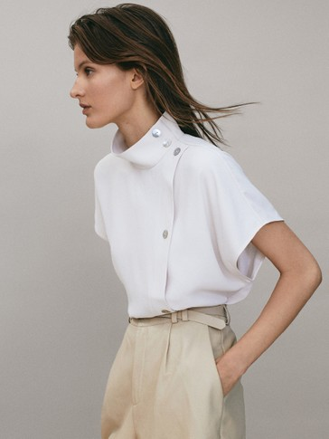 Blouse with shoulder buttons and placket