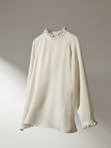 Shirt with ruffled neck and sleeves