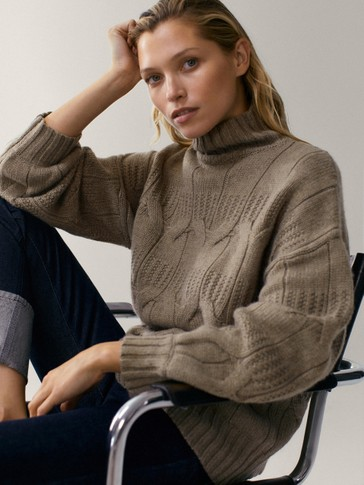 Cable-knit wool cape sweater with a high neck