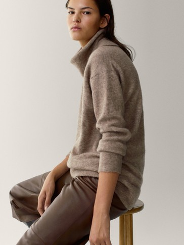 Oversized sweater with a high neck