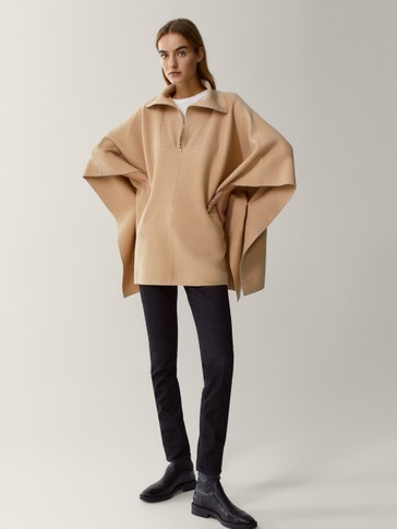 Cape with half-zip neck