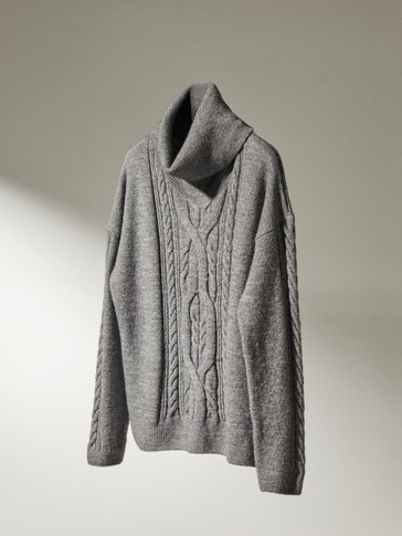 Cable-knit sweater with a high neck