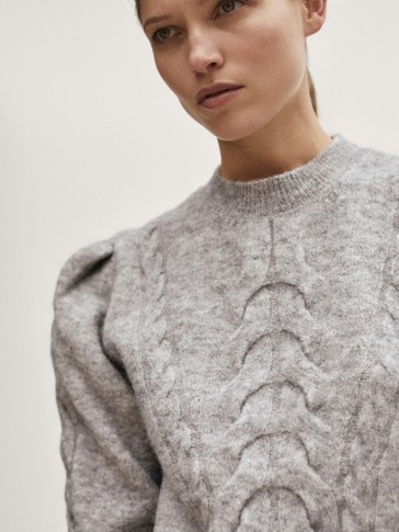 Cable-knit sweater with shoulder pleats