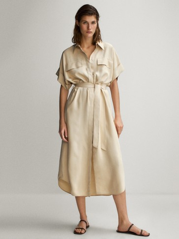 Shirt dress featuring pockets and belt