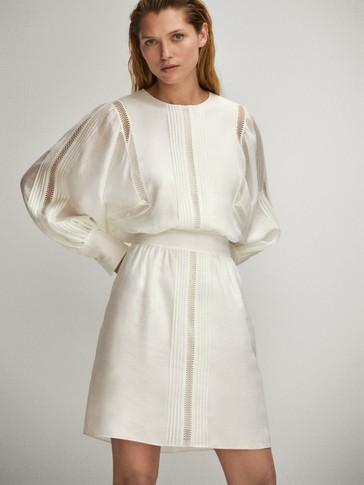Short linen dress featuring lace