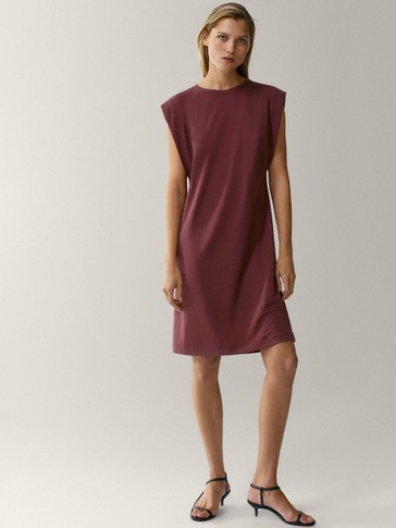 Tunic dress with shoulder pads