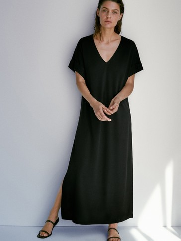Black dress featuring side slits
