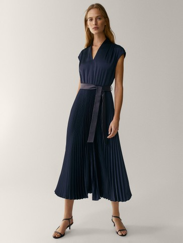 Navy blue pleated dress with leather belt
