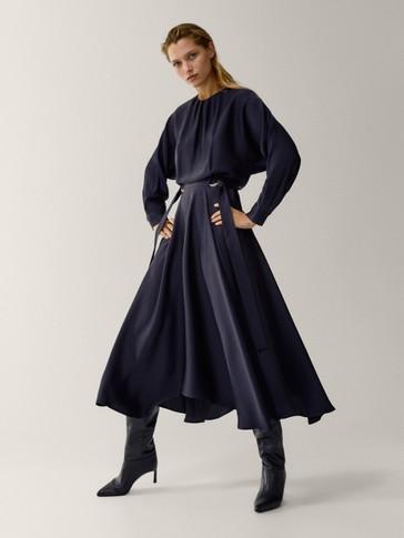 Flowing dress with asymmetric hem