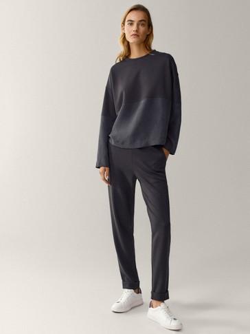 Kombinuotas džemperis apskrita iškirpte