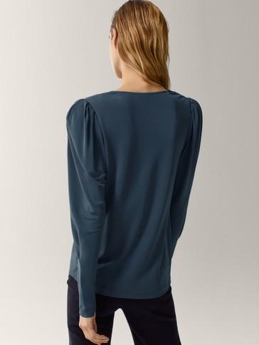 Flowing shoulder-padded top