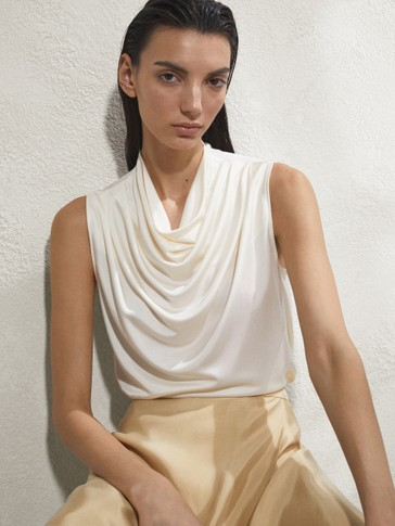 Draped sleeveless top