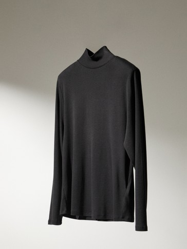 High-neck top with shoulder pads