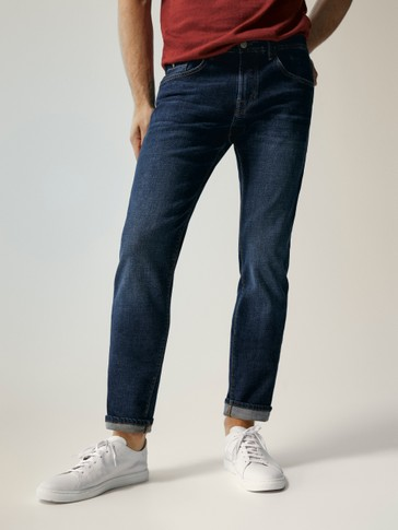 PANTALONS TEXANS STONE WASH SLIM FIT