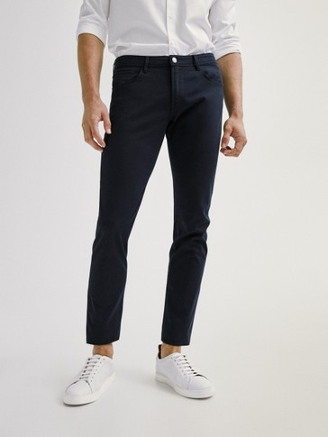 Pantaloni tipo denim broken in twill slim fit