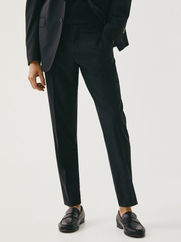 Black slim fit wool textured trousers