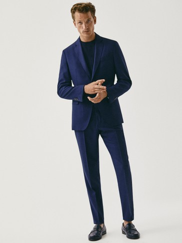 Navy blue wool slim fit trousers with a micro textured weave