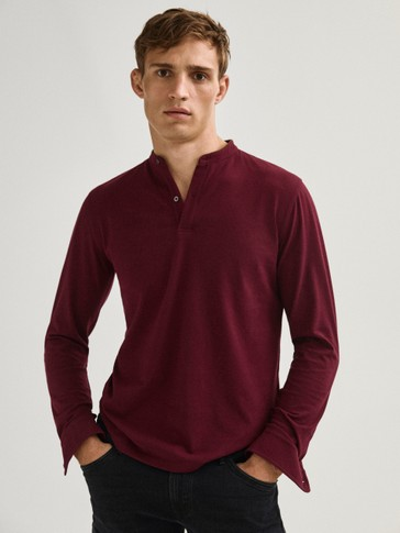 Polo shirt with stand-up collar and leather detail