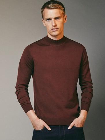 High neck sweater in 100% merino wool