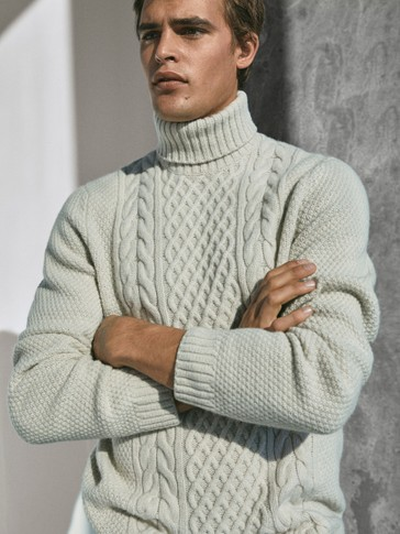 Cable knit high neck sweater