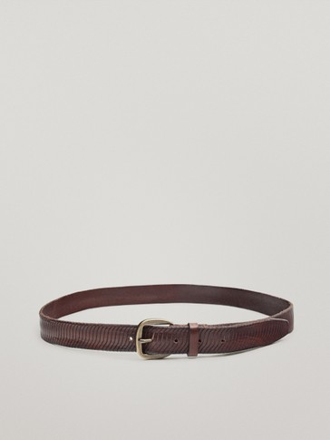 Leather belt with wavy embossing