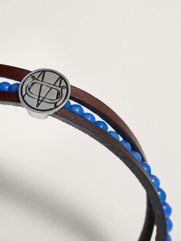 LEATHER BRACELET WITH BLUE BEADING