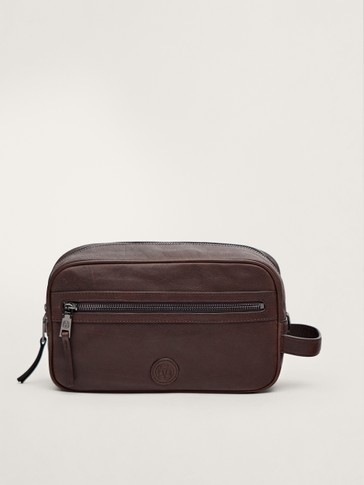 LIMITED EDITION FADED LEATHER TOILETRY BAG