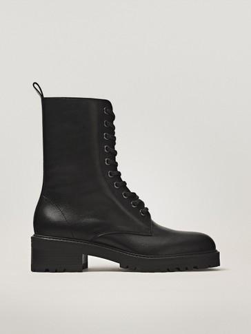 حذاء للكاحل مسطح لون أسود بأشرطة