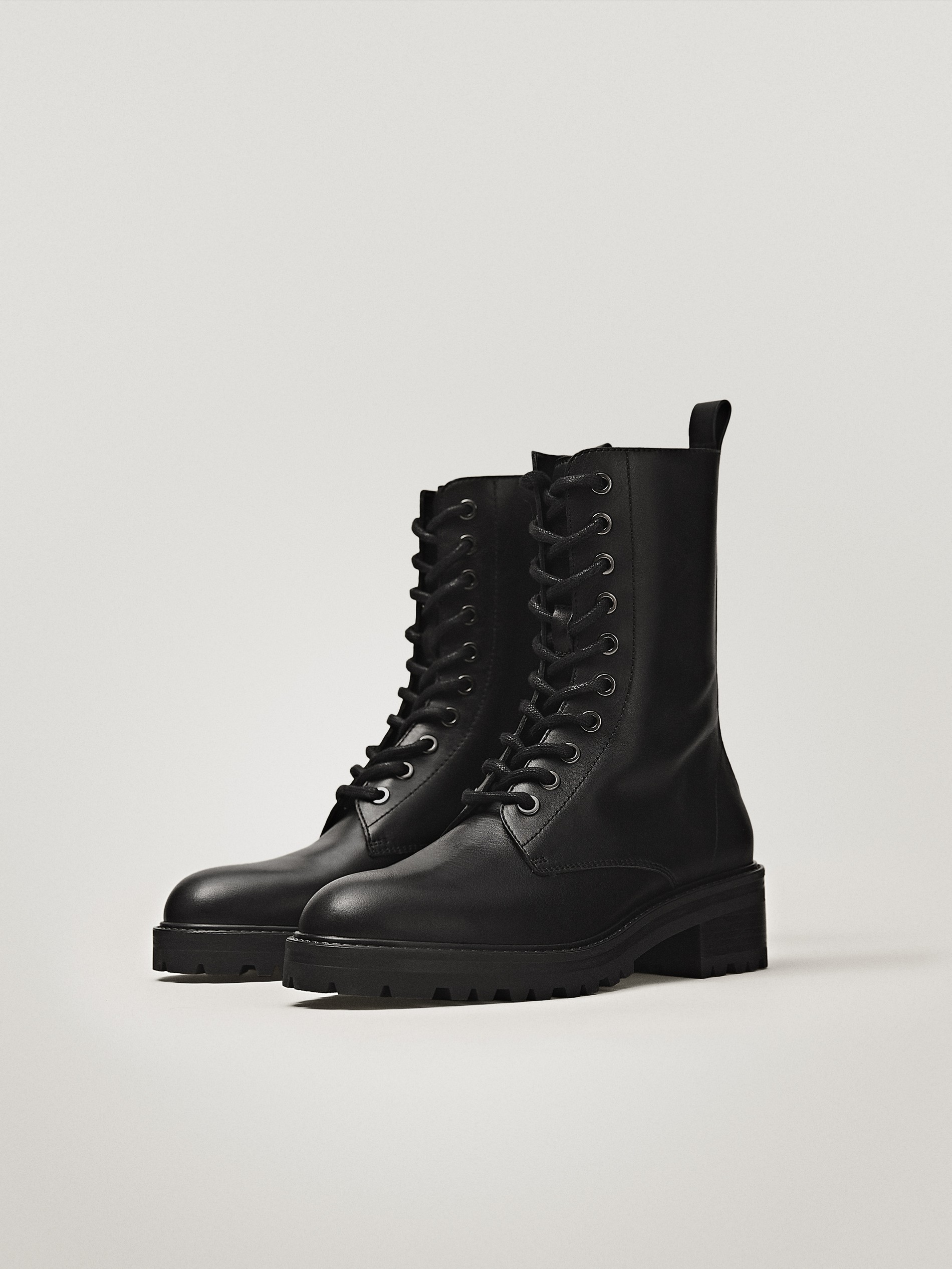 Black lace-up flat ankle boots - null