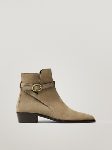 Leather ankle boots with leather buckle detail