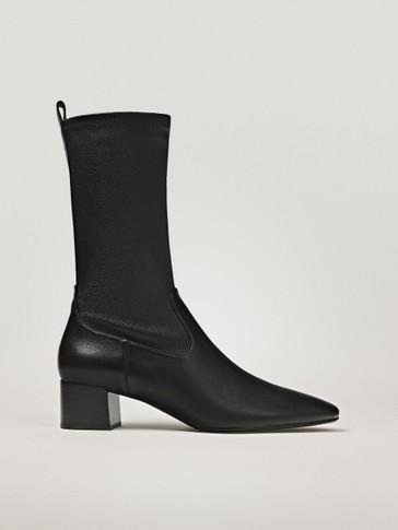 حذاء للكاحل مطاطي كعب عالي