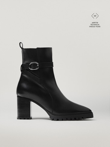 HIGH-HEEL LEATHER ANKLE BOOTS WITH TRACK SOLES