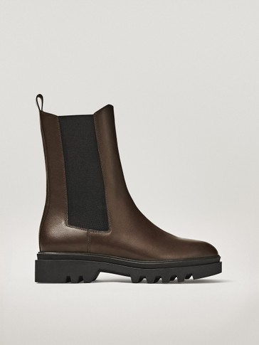 Chelsea boots with leather track sole
