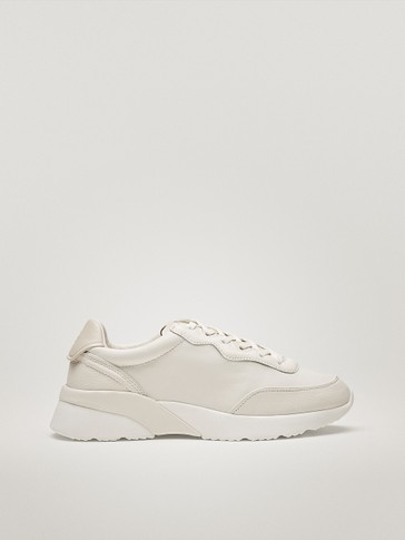 White trainers with leather piece sole detailing