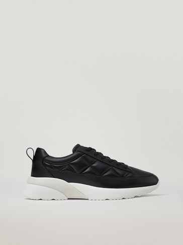 Padded black leather trainers