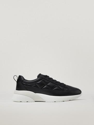 حذاء رياضي أسود مبطن من الجلد