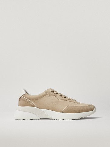 Trainers with leather piece sole