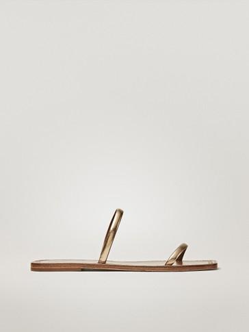 DOUBLE-STRAP FLAT GOLDEN SANDALS